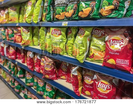 Nowy Sacz Poland - March 16 2017: Different types of Lay's Chips produced by American Corporation - Frito Lay and offered for sale in E.leclerc Supermarket.