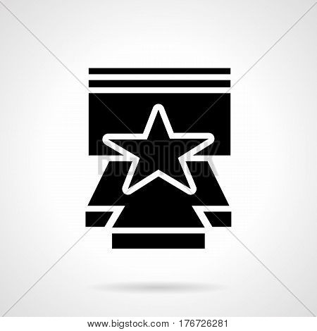 Abstract monochrome symbol of stage with star. Concerts, show and premiere with popular person. Symbolic black glyph style vector icon.
