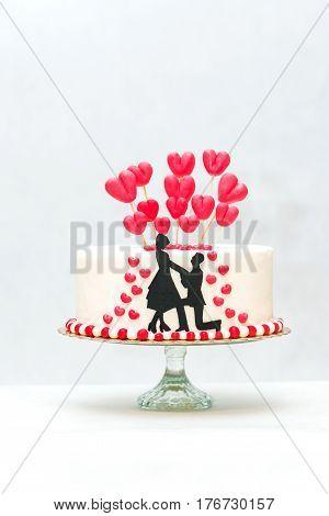 beautiful cake engagement on white background. handicraft