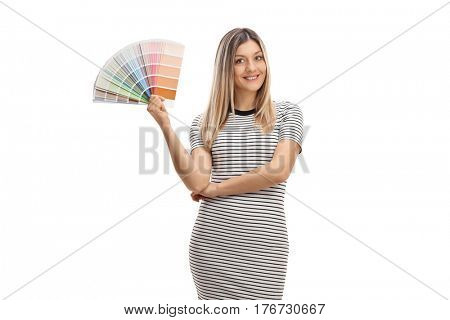 Pretty girl holding a color swatch and smiling isolated on white background