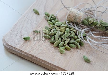 Dry Aroma Cardamon On The Wooden Board