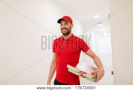 food delivery, mail and people concept - happy man delivering pizza in paper boxes