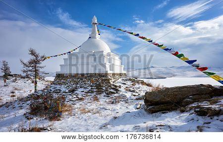 Enlightenment Stupa on island of Ogoy in early March. Irkutsk region. Olkhon area. Russia poster