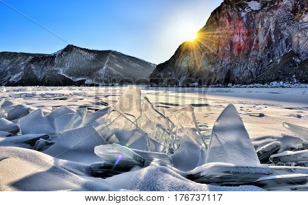 Ice hummocks on Lake Baikal in evening sunshine. Olkhon Island. Irkutsk region. Russia