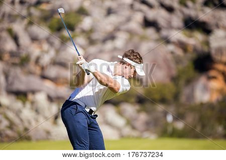 Close Up Image Of A Male Golfer Playing A Shot On The Fairway On A Golf Course In South Africa.