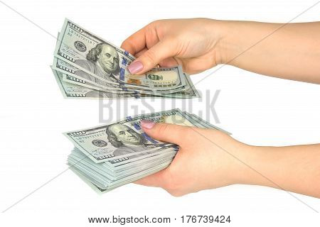 Female hands consider dollars, isolated on a white background