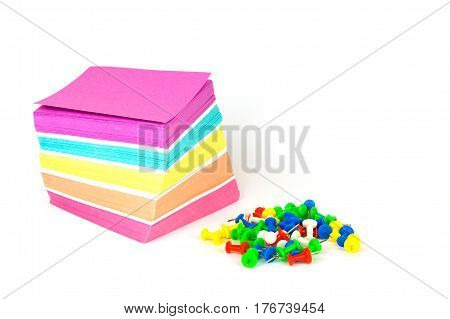 Colorful note paper and pins isolated on a white background. Close up