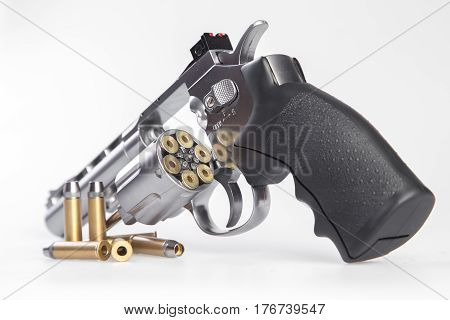 Close up view of a airsoft gun isolated on a white background.