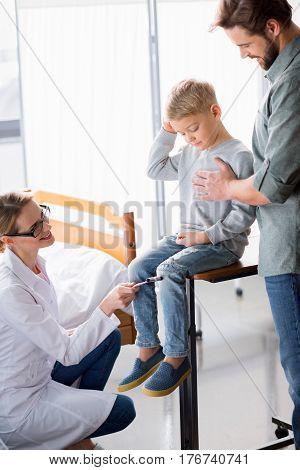 Doctor Inspecting Little Boy