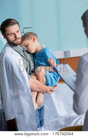 Father And Son Visiting Doctor