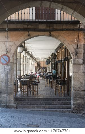 LEON, SPAIN - JULY 26, 2016: Leon (Castilla y Leon Spain): historic buildings in Plaza Mayor the main square of the city. People under the portico