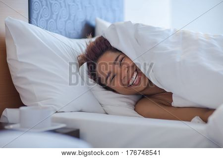 Young Happy Black Woman Lying In A Bed.