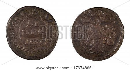Old russian coin during the reign of the Empress and Autocrat of All-Russia Anna Ivanovna Romanova with the emblem of an eagle and a shield with floral ornaments