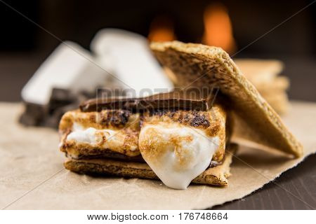 Toasted Marshmallow on Smore with graham cracker resting on side