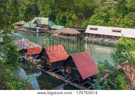 Tourism on the floating house rafting at the river Kwai, Kanchanaburi , Thailand