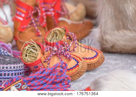 Traditional sami handmade leather footwear for children made from reindeer hide