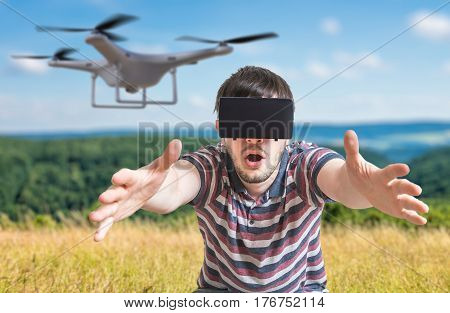 Man Wearing Virtual Reality Headset Is Controlling A Flying Dron