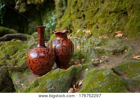 Beautiful decanters with water on a stone natural background