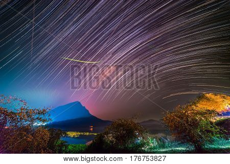 Startrails over swamp and mountain in rural.