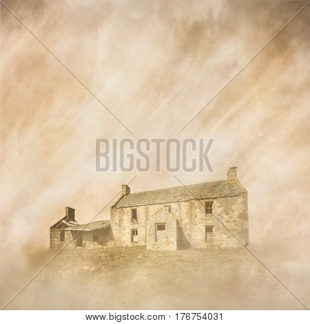 Abandoned, derelict farmhouse in a dusty, windblown landscape captured using long exposure, bokeh and other effects with some areas blurred to create a surreal and dreamlike effect.
