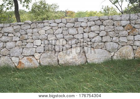 traditional massive stone fence in countryside of Slovenia