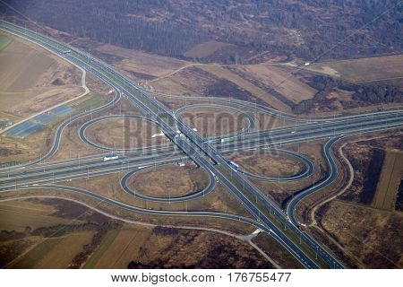 Aerial highway junction. Highway shape like number 8 and infinity sign.