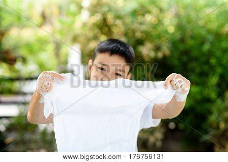 Boy Washing Cloth By His Hand