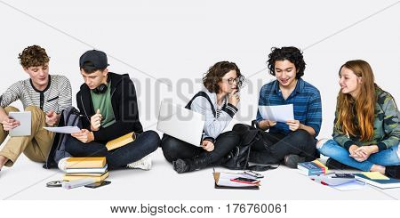 Group of Young Adult Students Studying Reading Books