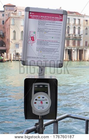VENICE ITALY - JANUARY 11; Ticket validation point for Actv network for travelers when boarding a boat in Venice Italy - January 11 2017: Actv is water bus network with 19 scheduled lines that serve locals and tourists within Venice.