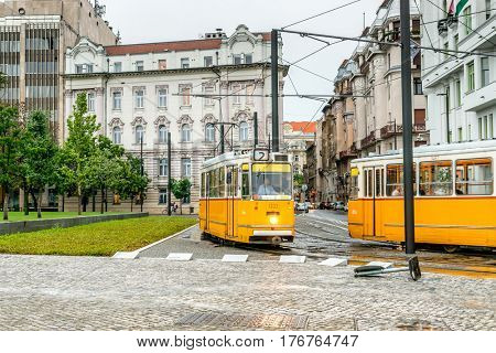 BUDAPESHT, HUNGARY- JULY 08: Comfortable yellow buses used for public transportation in broad daylight on july 08, 2015 in Hungary