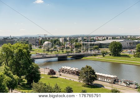 POLAND, KRAKOW- JULY 03: Urban areas modern bridge and the river, gardens and alleys to wall in Krakow Poland on July 03, 2015