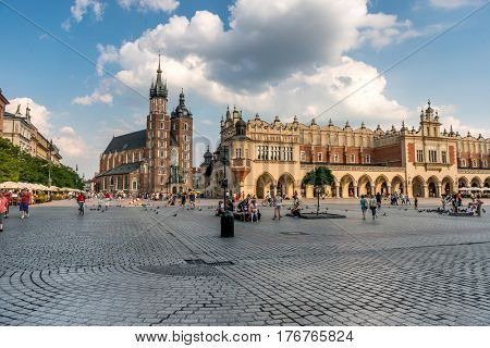 POLAND, KRAKOW- JULY 01: Breathtaking eastern european cobbled square arched building, on a cloudy day in Krakow Poland on July 01, 2015
