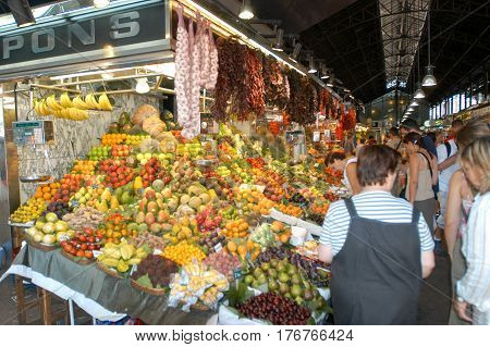Vendor And Customer At A Vegetable And Fruit Shop In Barcelona