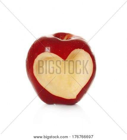 Fresh red apple with heart-shaped cut out  on white background