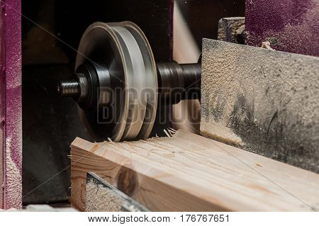 Close Up Of A Straight Router Bit Cutting A Groove Or Rabbet In A Piece Of Oak
