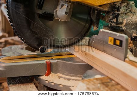 Circular Saw With A Wooden Beam And Measuring Scale