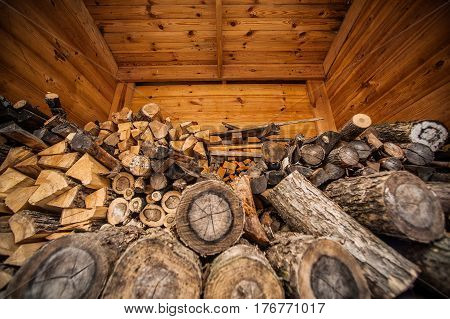 Natural Wooden Background, Closeup Of Chopped Firewood. Firewood Stacked And Prepared For Winter Pil