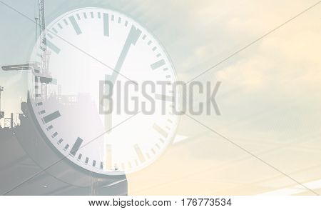 Clock Face double exposure on construction site for backgorund copy space
