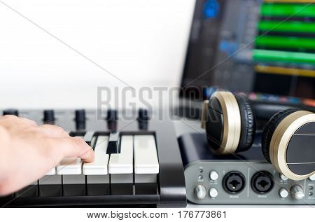 Musician is recording Portable Computer Music Studio home set up