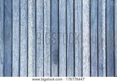 slats of a used blue wooden panel background