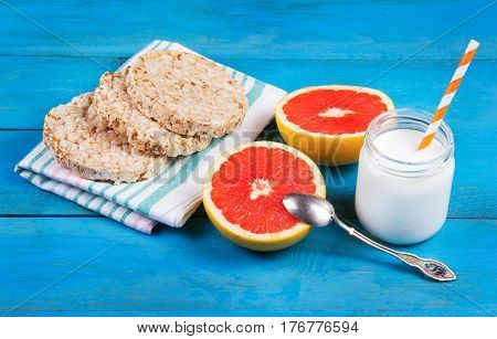 Healthy eating. Bread wheat from the air with honey half a grapefruit and homemade yogurt without sugar.