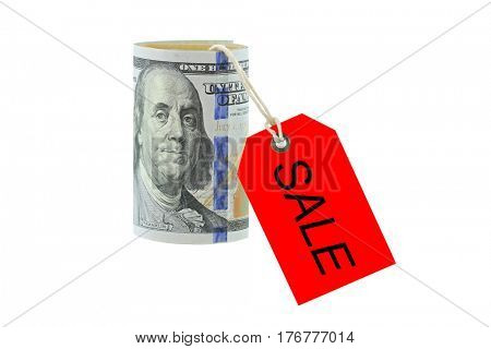 Rolled new United stated 100 dollar banknote, money roll with red SALE tag hanging, isolated on white background