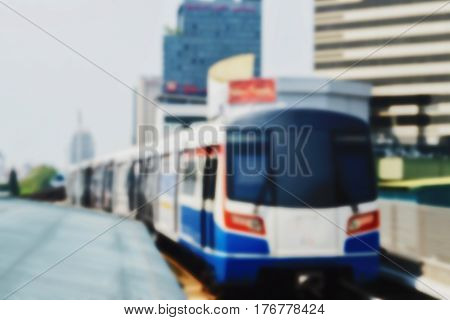 blurred photo Blurry image people At station Electric train background