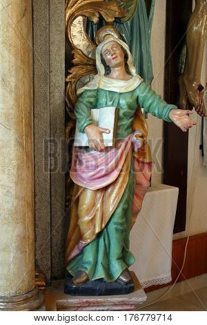 POKUPSKO, CROATIA - JULY 10: Saint Ann statue at the altar in the Parish Church of Assumption of the Virgin Mary in Pokupsko, Croatia on July 21, 2011.