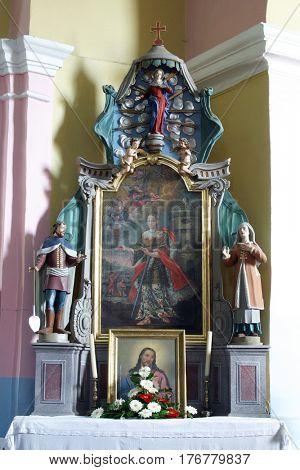 PISAROVINSKA JAMNICA, CROATIA - AUGUST 21: The altar of Saint Barbara in the Parish Church of Saint Martin in Pisarovinska Jamnica, Croatia on August 21, 2011.