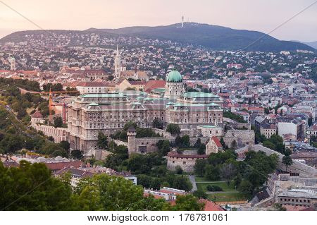 Evening panorama of Budapes from Gellert Hill with a beautiful sunset sky. Royal Palace at dusk