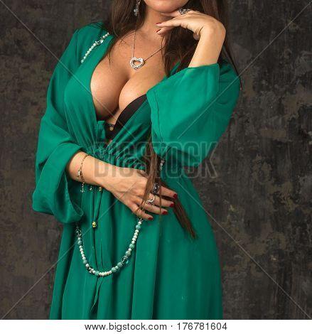 Green luxury bathrobe wearing on Beautiful woman