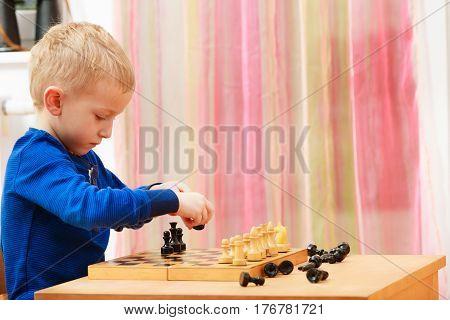 Young Kid Boy Playing Chess Having Fun