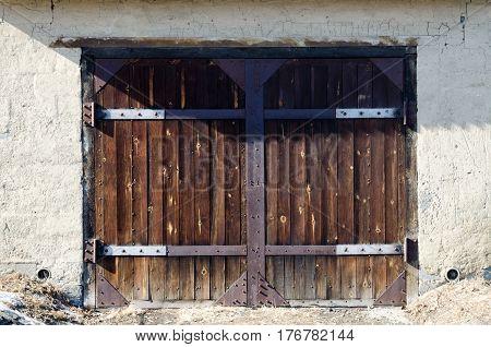 Old Dark Wooden Garage Door for car