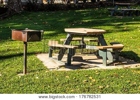Picnic Bench With BBQ At Local Park